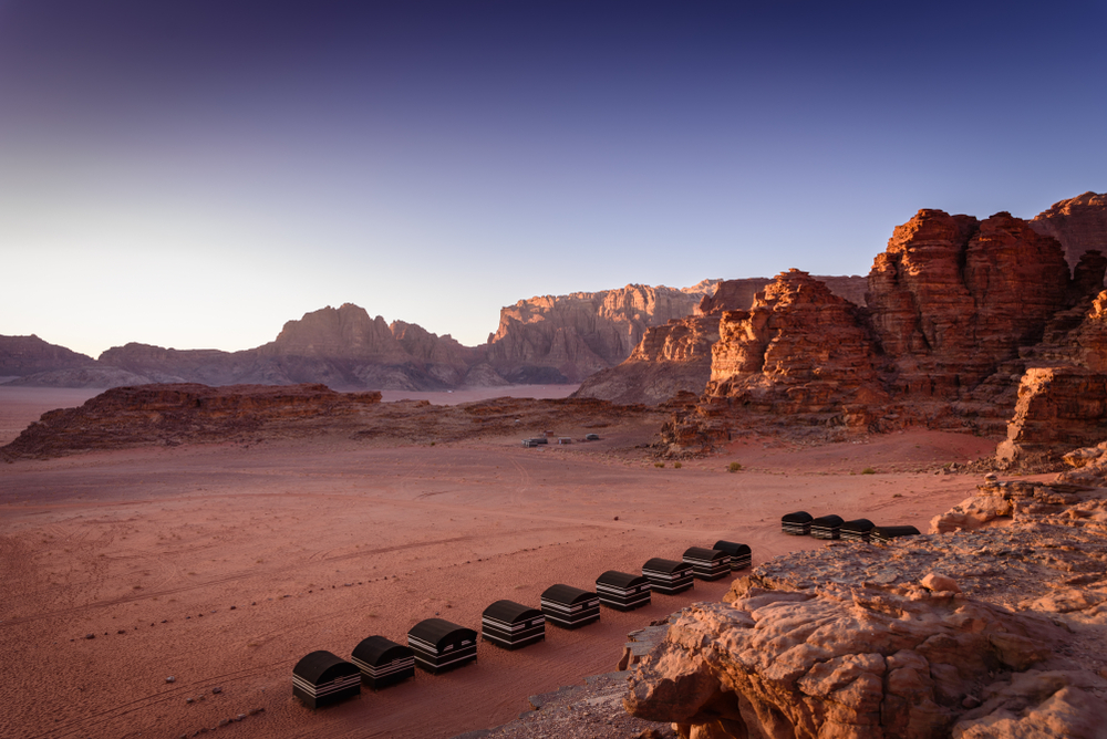 Would you like a visit to Wadi Rum desert with sweeping red sand dunes and towering sandstone arches? Read all about how you can visit